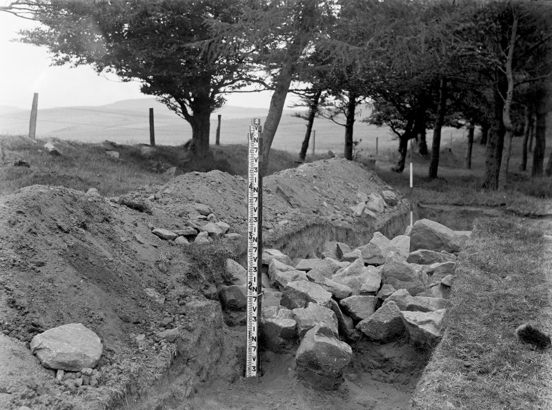 View of remnants of the perimeter of the cairn on the NNE side of the ring as viewed from the S during excavations at Old Keig in 1933.