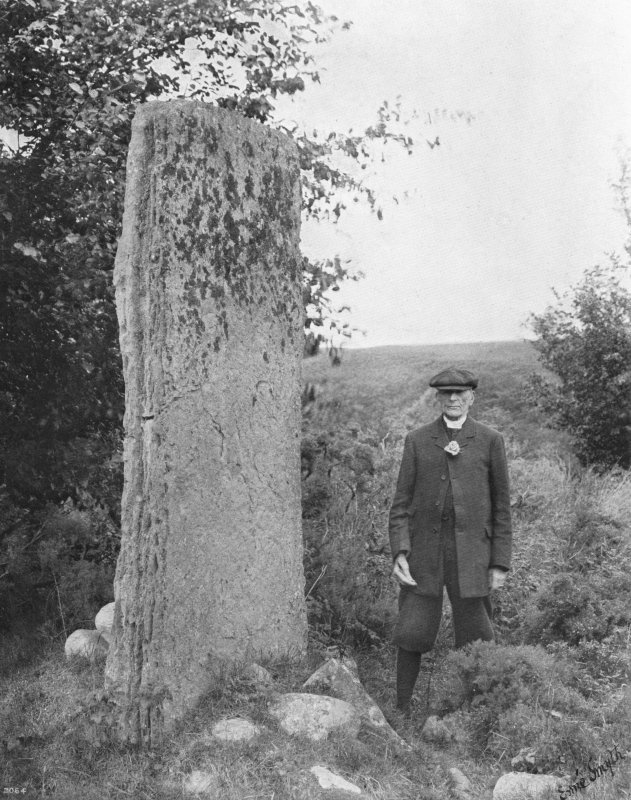 The Right Reverend George Forrest Browne, Quondam Bishop of Stepney & Bristol, Disney Professor of Archaeology at the University of Cambridge, etc., acting as a 6ft scale for the tallest monolith at Balnuaran of Clava North East (Browne, G. F. 1921 On Some Antiquities In The Neighbourhood Of Dunecht House Aberdeenshire Pl XXXVI)
