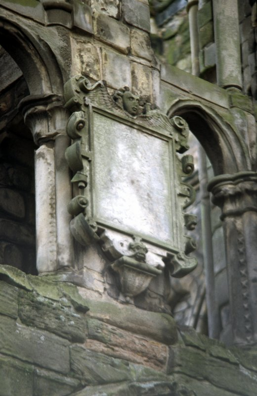 View of panel with angel's head and grotesque mask, above W door of Holyrood Abbey..