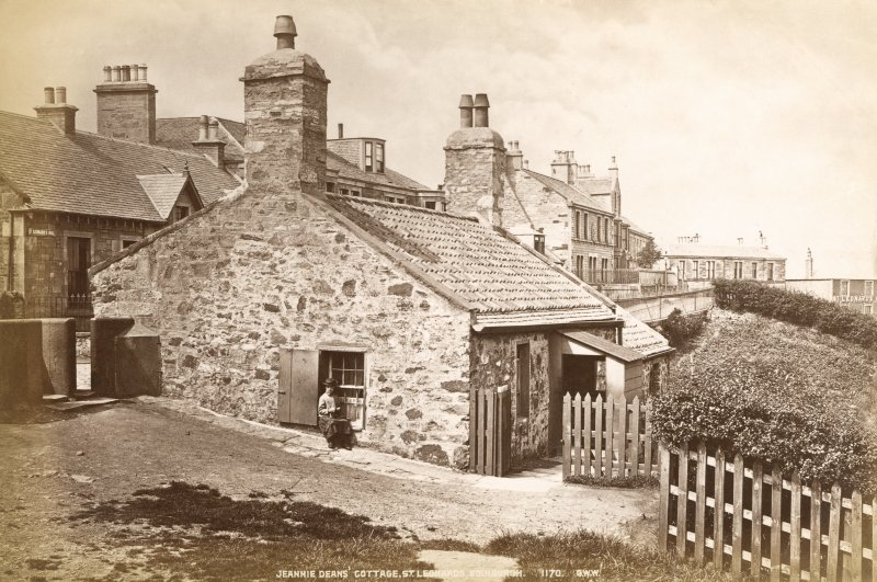 View of cottage in Holyrood Park from East, with woman sitting on window frame. Titled: 'Jeannie Dean's Cottage, St. Leonards, Edinburgh.  1170.  G.W.W.' Since demolished.
