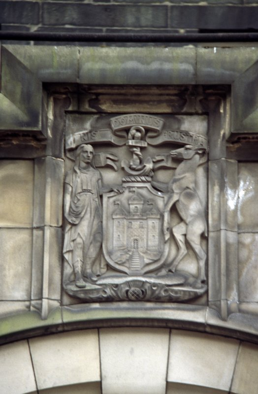View of carved coat of arms of Edinburgh, above door arch to City Chambers (16 Cockburn Street).