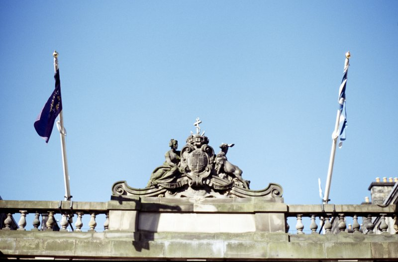 View of carved coat of arms of Edinburgh, above central arch of S screen of City Chambers (High Street).