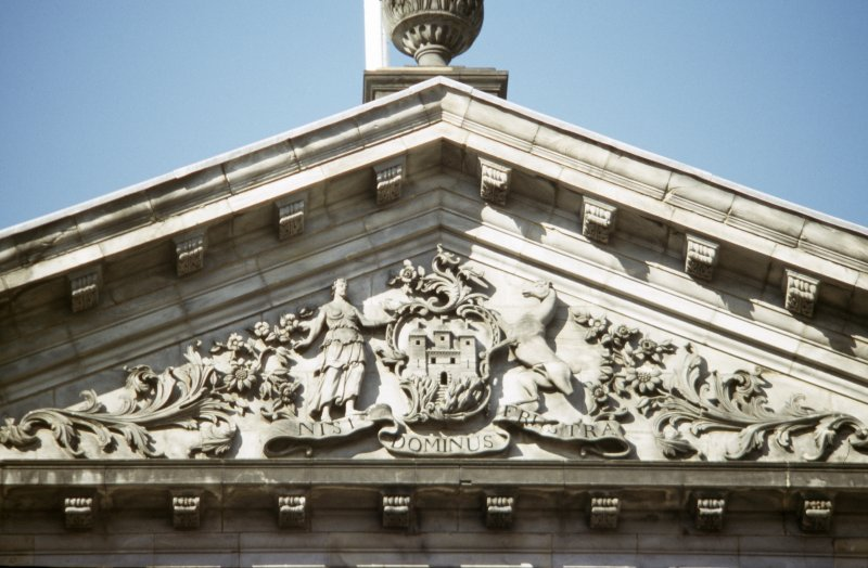View of carved coat of arms of Edinburgh, in central pediment of S facade of City Chambers (High Street).