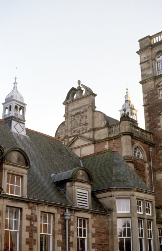 View of part of N facade of New Craig, showing Royal Arms of Scotland.