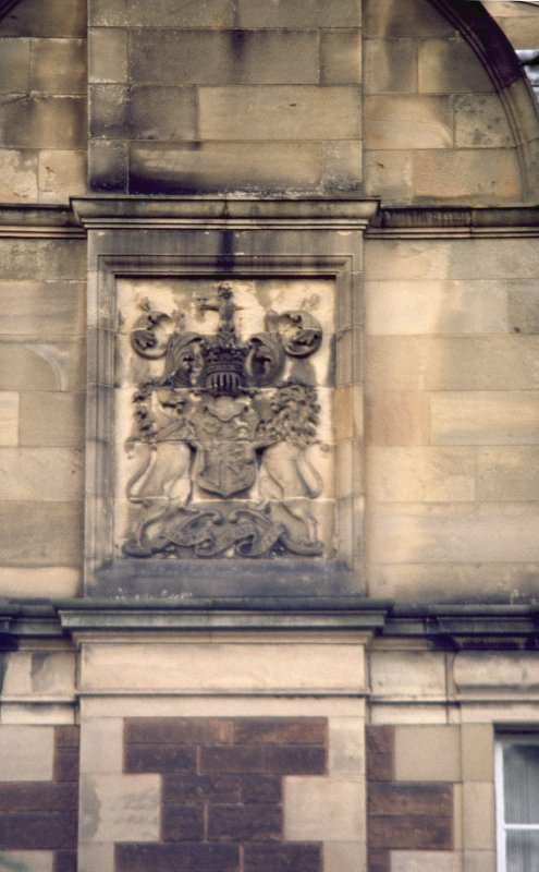 View of part of S facade of New Craig, showing Royal Arms of Scotland.