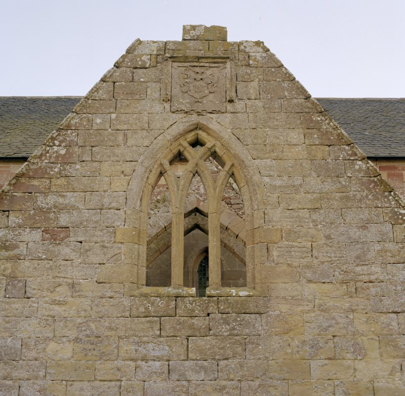 Fearn Abbey.  Ross aisle, view of traceried window and ross armorial, North gable.