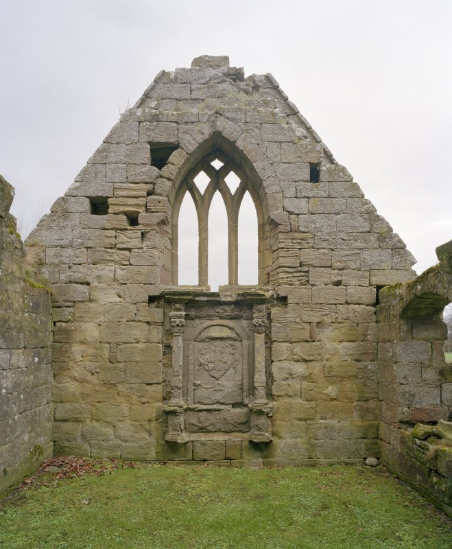 Fearn Abbey.  Ross aisle, view from South showing Ross monument with traceried window above.