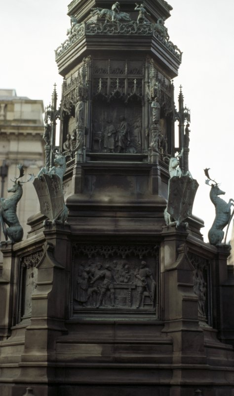 View of E side of pedestal of Monument to the Duke of Buccleuch, showing bronze panels. The upper panel shows the installation of the Duke as Chancellor of Glasgow University; the lower panel shows the attempted rescue of James V by Sir Walter Scott of Buccleuch and Branxholm in 1526.
