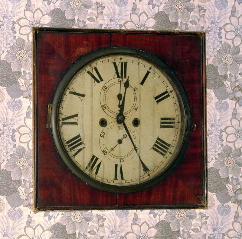 Interior. Basement, SW room, detail of wall clock.