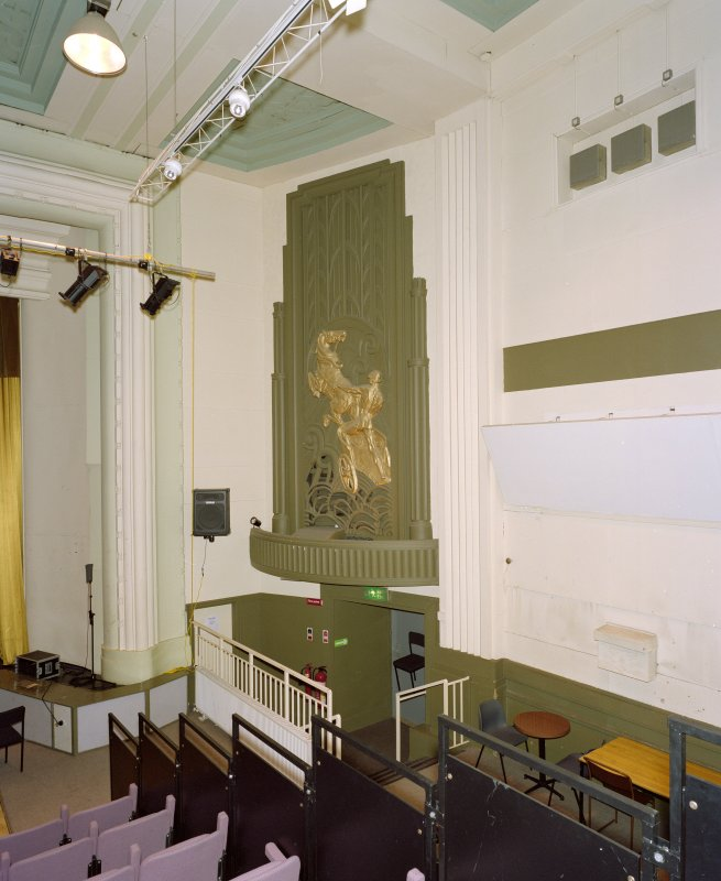 Interior. Main cinema (now theatre), view from W showing panel with charioteer relief