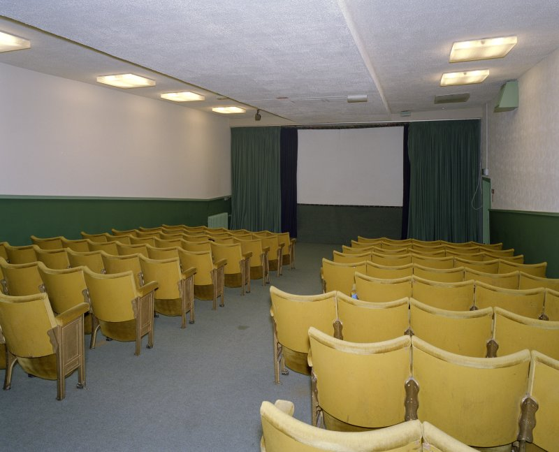 Interior. Small cinema, view from NE showing screen