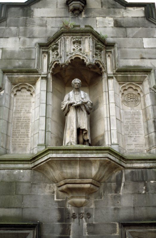 View of statue of Dr Andrew Bell in niche.