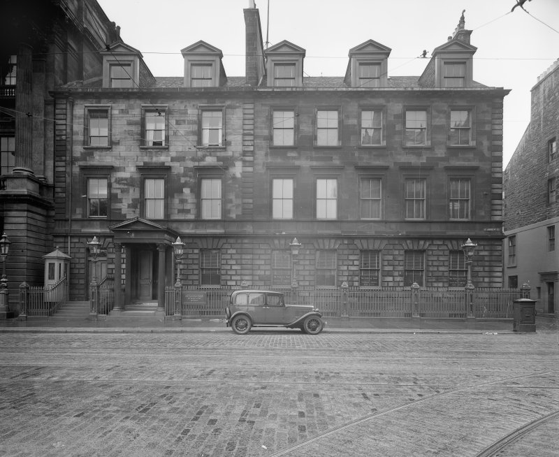 General view from West with car in front of the building