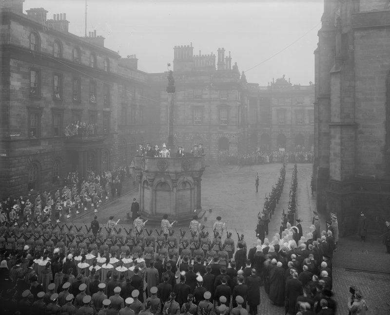 Proclamation of the Accession of King George VI.From left to right on Mercat cross, Captain HAB Lawson, Unicorn Pursuivant, Thomas Innes of Learney, Albany Herald, Sir Francis Grant, Lord Lyon King of Arms, Sir Alexander Hay Seton of Abercorn, Carrick Pursivant and Lt. Col. JW Balfour Paul, Falkland Pursuivant.Ceremony  in Parliament Square