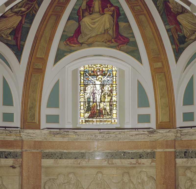 Interior, detail of central stained glass window in chancel