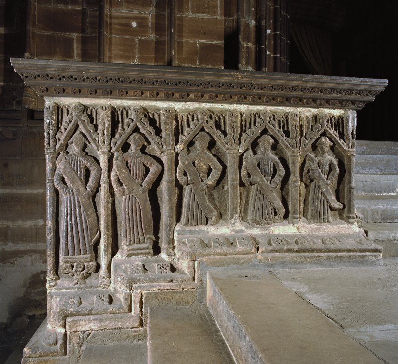 Interior. Detail of carved figures on west face of choir screen.