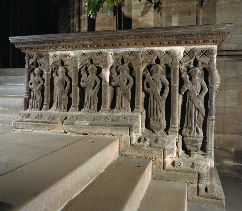 Interior. Detail of carved figures on choir screen.