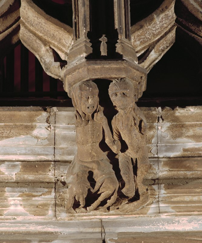 Interior. Detail of carved figure on choir screen.