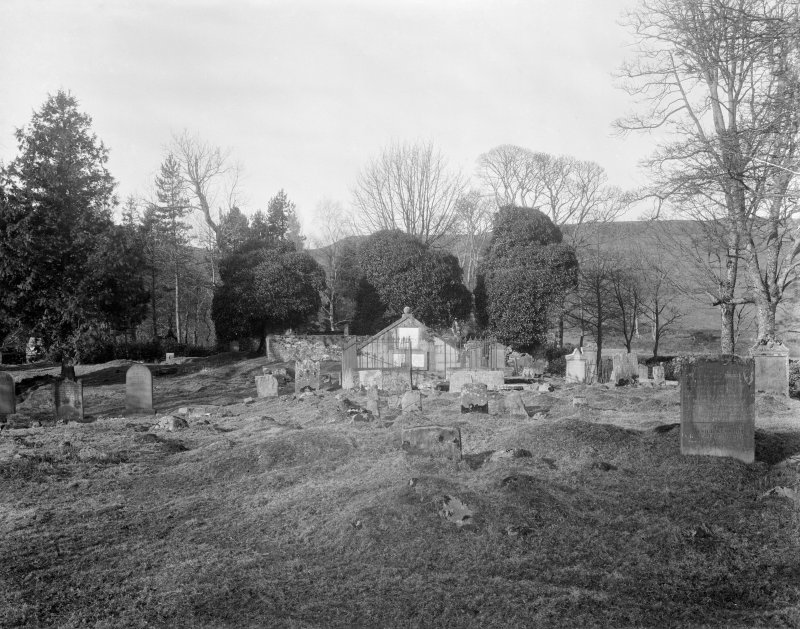 View looking across graveyard to presbytery.