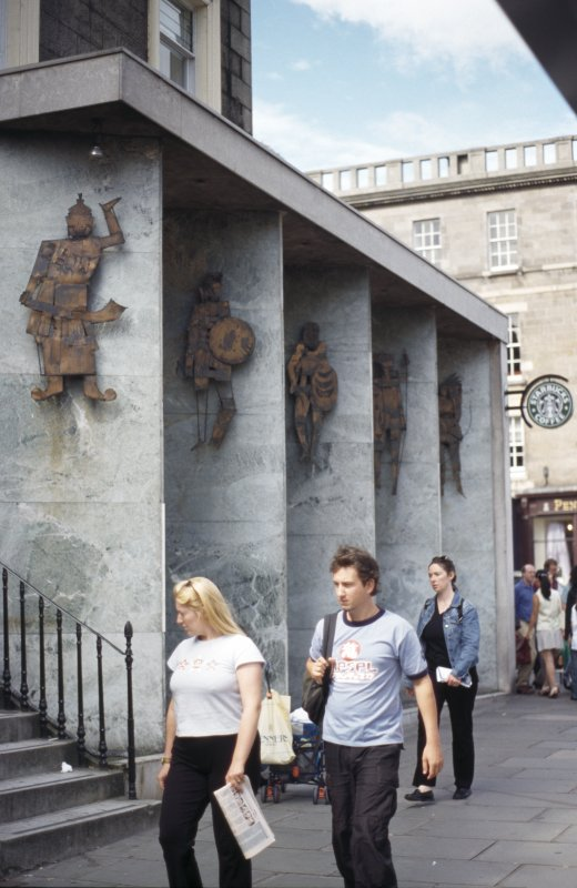 View of metal warriors on Hanover Street facade.