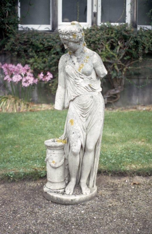 View of sculpture of a female figure, in garden of Dalmeny House.