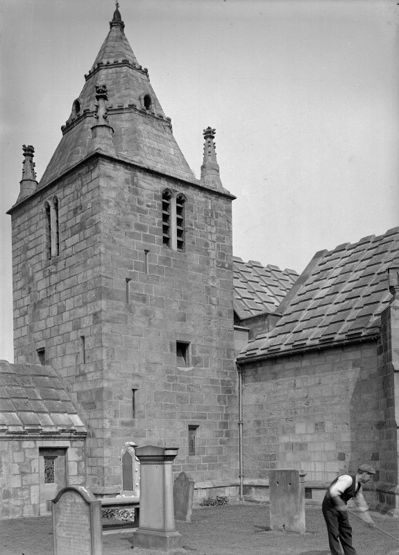 Edinburgh, Kirk Loan, Corstorphine Parish Church. General view of tower from South, with man raking.
