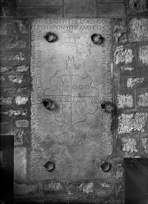 Edinburgh, Kirk Loan, Corstorphine Parish Church. View of stone in South transept. Slab with incised armorial and inscription. Insc:'M.I.W,HediedThe1May,1620.Thus.Saith.The.Lord.God.Unto.These.Bones.Behold.I.Wil.Cause.Breath.To.Enter.Into.Yow.And.Ye.Shall.Live.And.I.Wil.Lay.Sinewes.Upon.Yow.And.Wil.Bring.Up.Flesh.Upon.Yow.And.Cover.Yow.With.Skin.And.Put.Breath.In.Yow.And.Yow.Shall.Live.And.Ye.Shal.Know.that.I.Am.The.Lord.Ezekiel.37.Chap.5 Vers'.