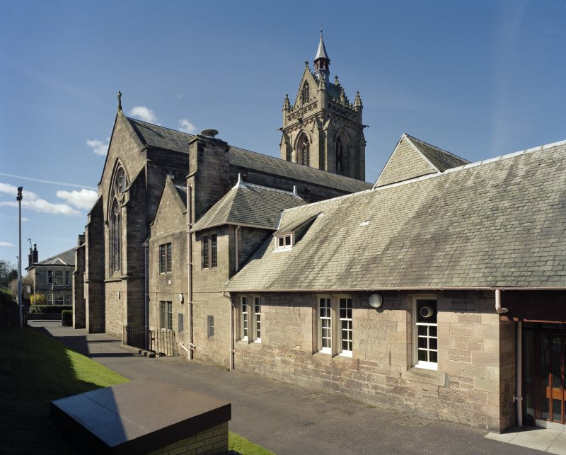View of church, vestry and kitchen block from east
