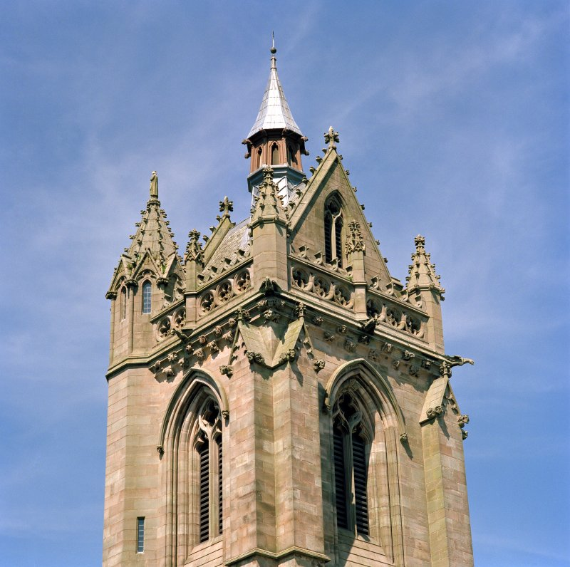 View of tower showing parapet and steeple from south