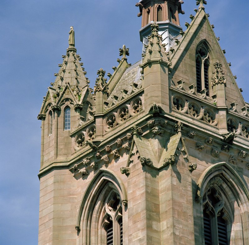 Detail of south side of tower showing roof, fleche and turret