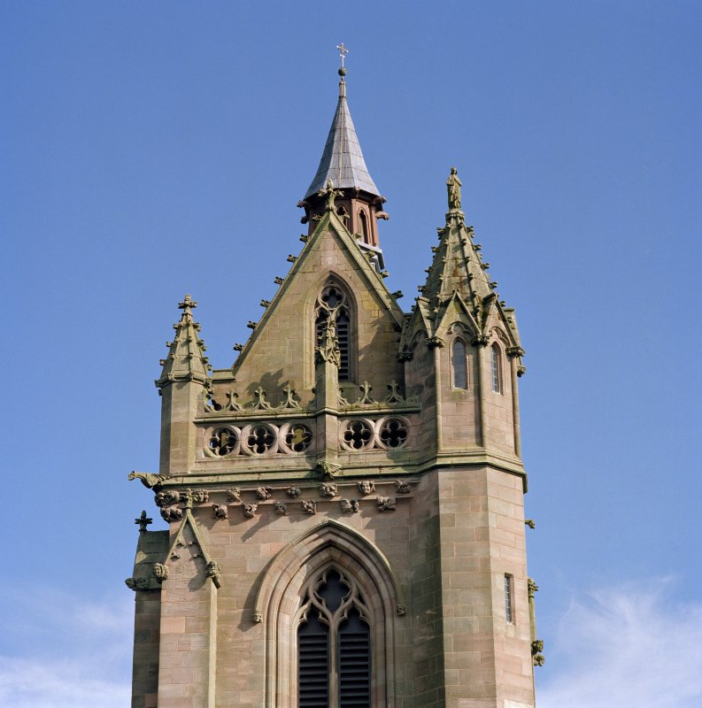 View of north side of tower, statue of St. James and fleche