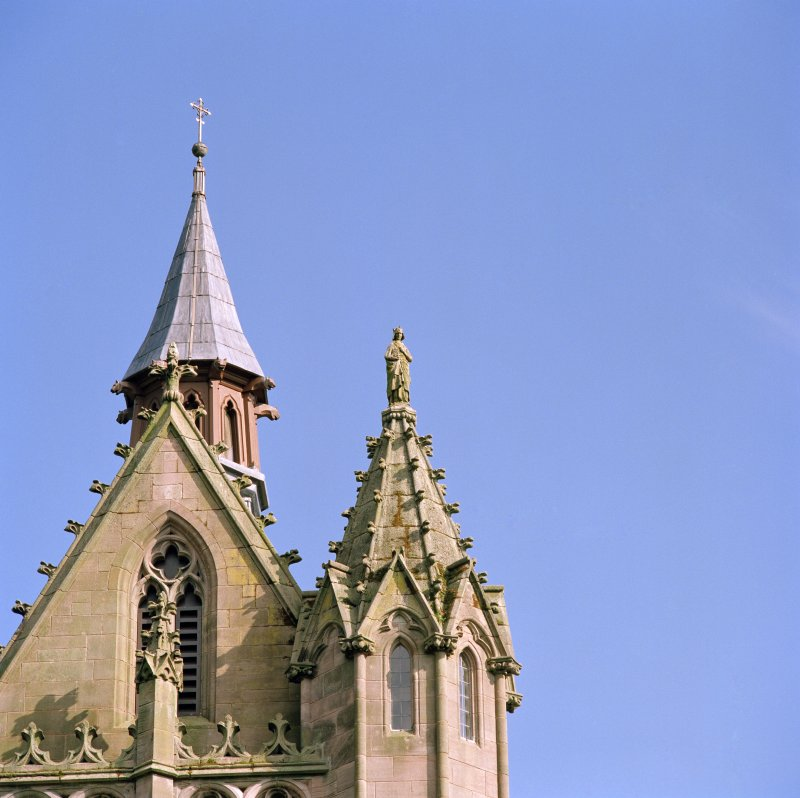 Detail of north side of tower showing statue of St. James and fleche