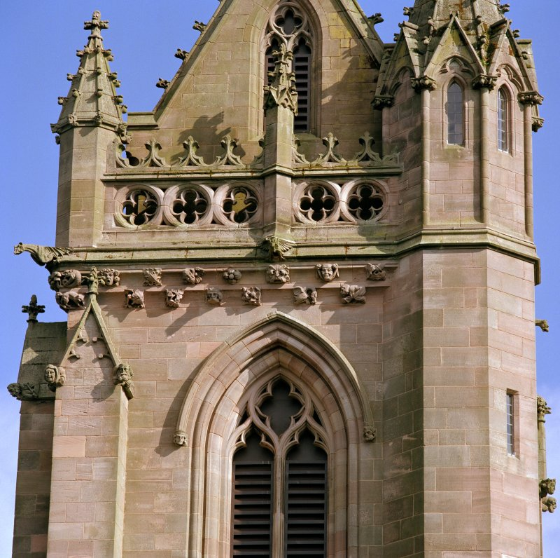Detail of north side of tower showing carved heads and gargoyles