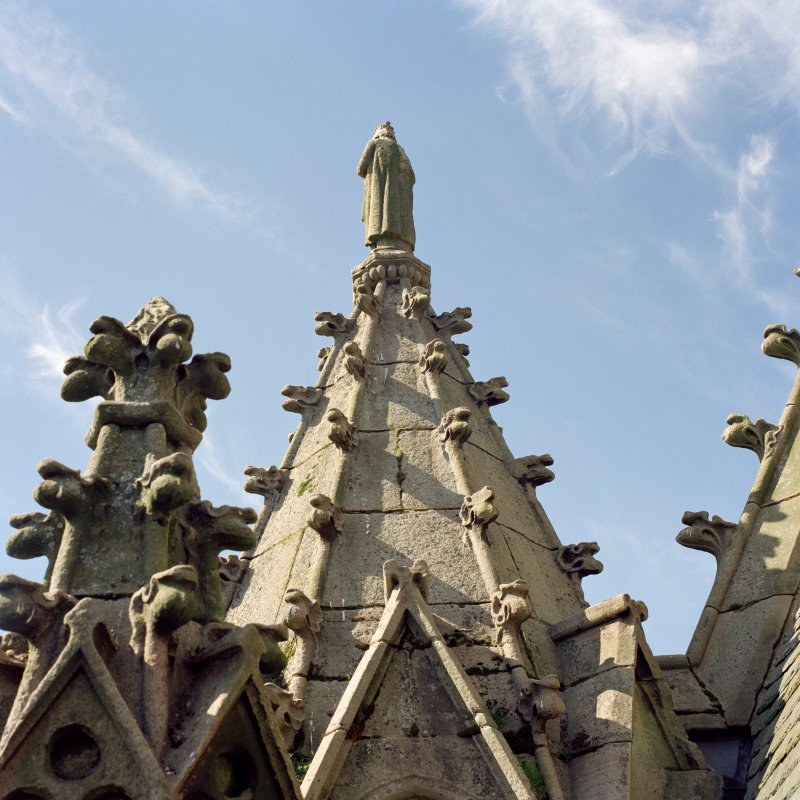 Detail of pinnacle on corner of tower with statue of St. James