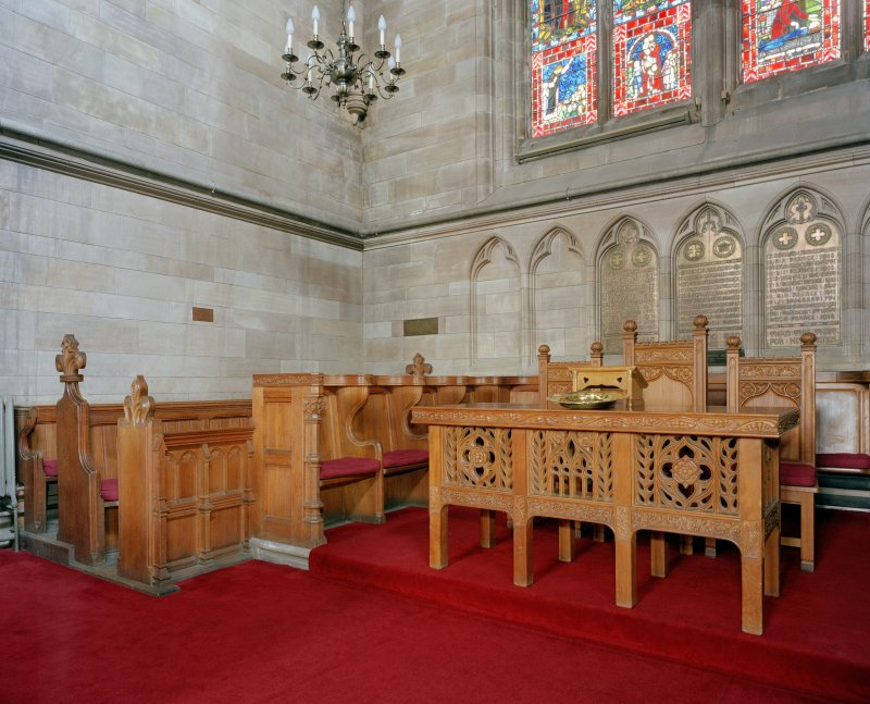 Interior.  View of altar table and pews in chancel