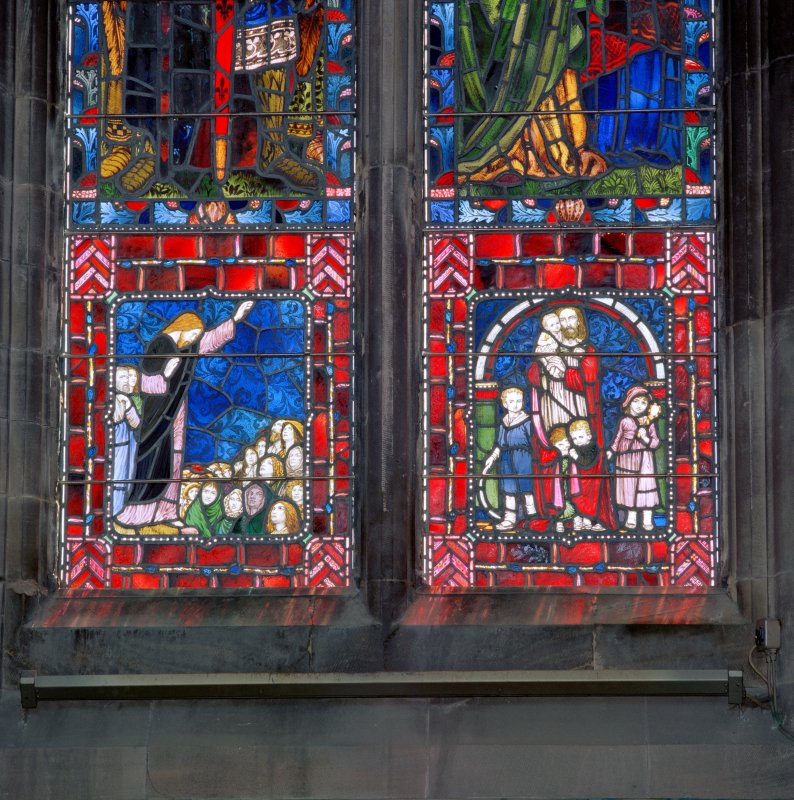Interior.  Stained glass window in south east wall, detail of two panels in bottom left hand corner
