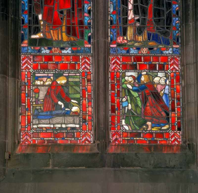Interior.  Stained glass window in south east wall, detail of two panels in bottom right hand corner