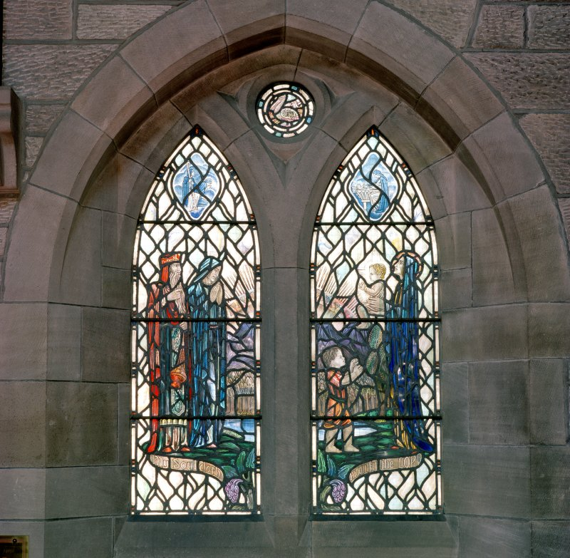 Interior.  View of stained glass window in north wall 'My soul doth magnify the Lord'