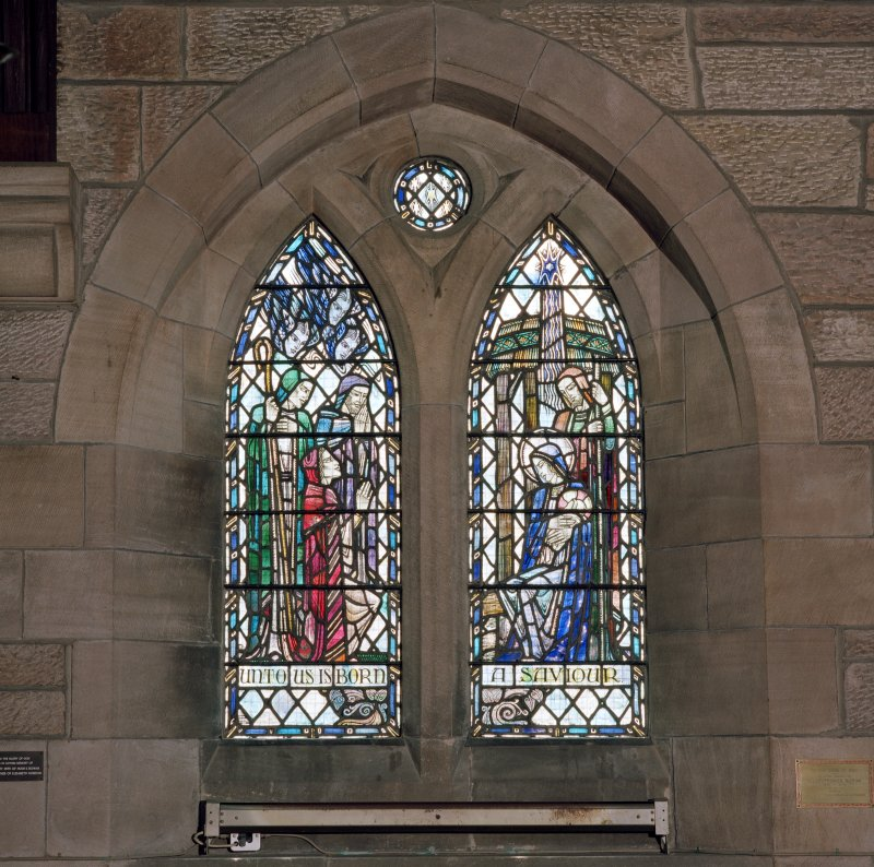 Interior.  View of stained glass window in south wall 'Unto us is born a Saviour'