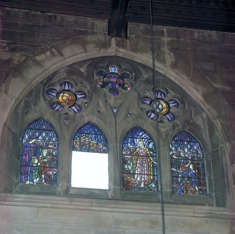 Interior.  View of stained glass window in north wall of chancel