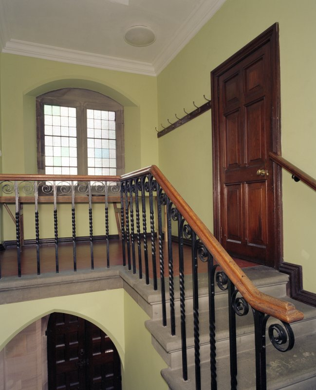 Interior.  Staircase leading to manager's room, view from landing to east