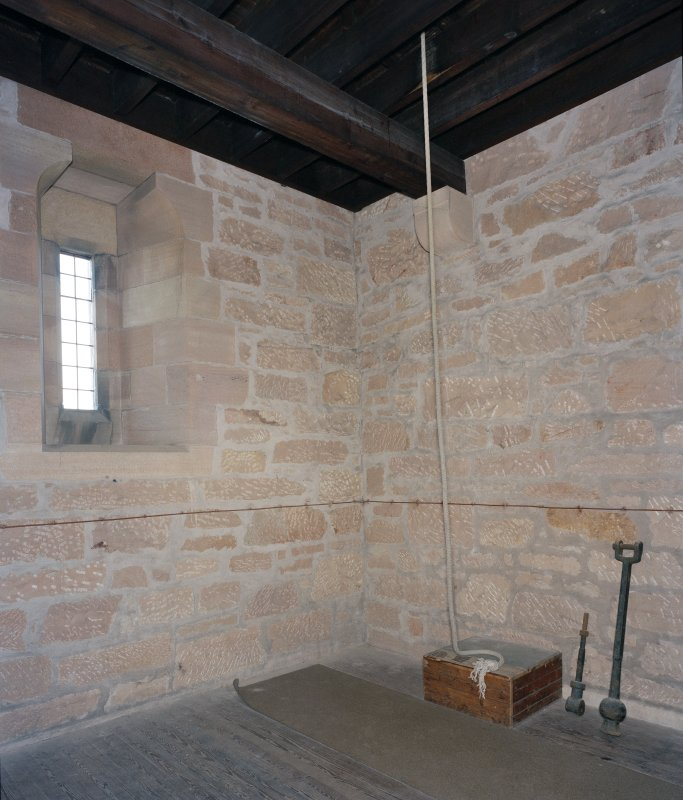 Interior.  Tower, 1st. floor, room with bell rope, view from south west
