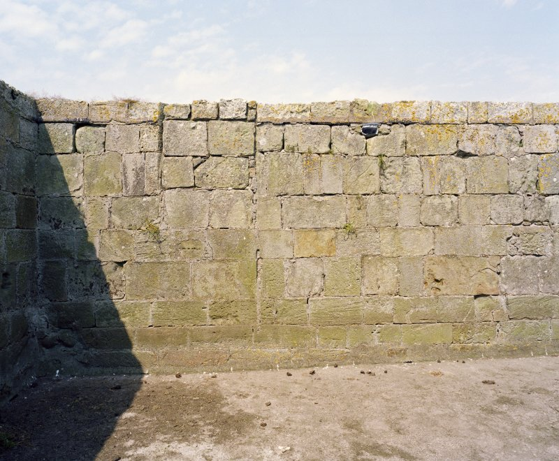 Interior of North wall, view of West end from South.