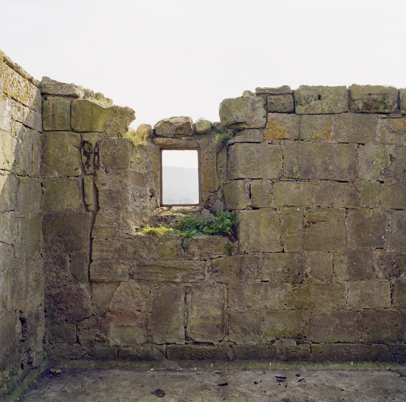 View of East window and surrounding masonry to interior of South wall.