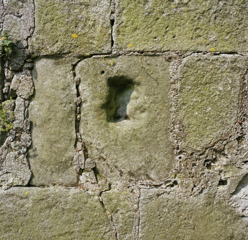 Detail of stone with indentation to inside of West wall.