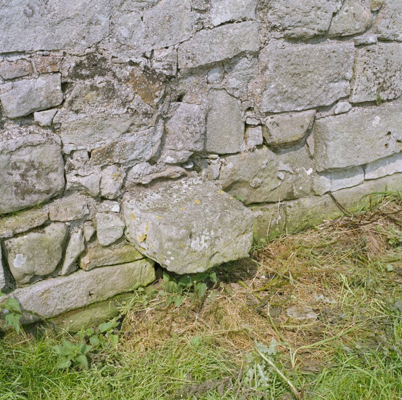 Detail of projecting stone at base of East wall.