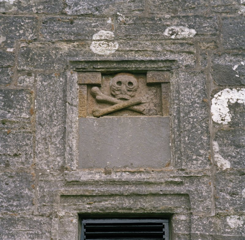 Detail of skull and crossbones in panel above entrance