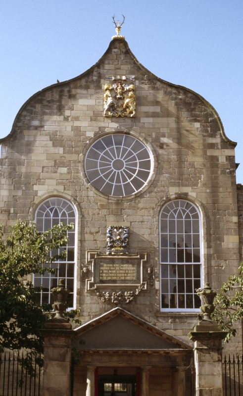 View of Canongate Kirk, showing arms of William III above circular window, arms of Thomas Moodie and inscription panel between arched windows.