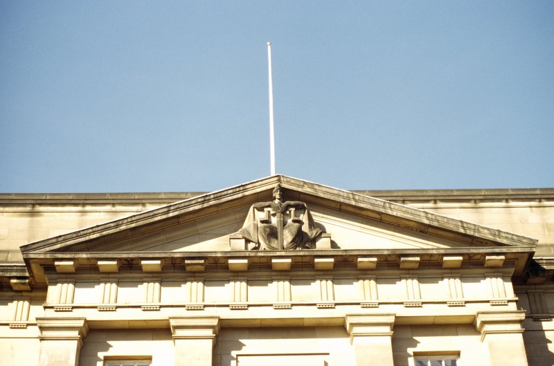View of sculpture representing 'Justice', in pediment on High Street facade.