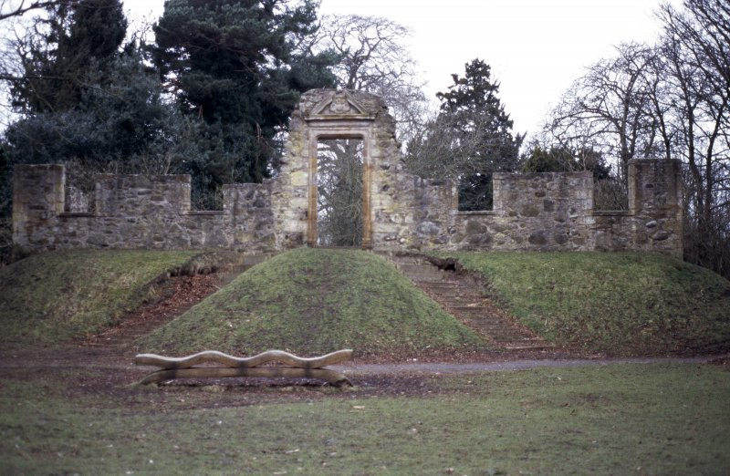 View of remains of Cammo House, showing coat of arms of the Menzies family in pediment.